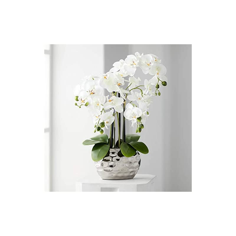 faux orchid in silver resin pot